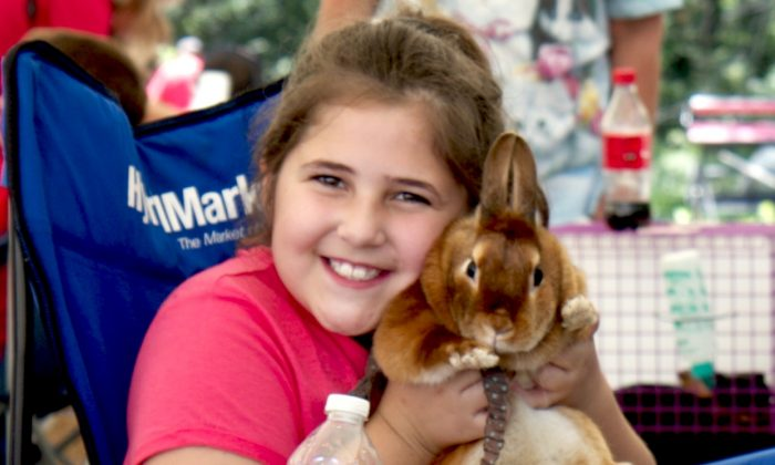 Rachael Cesarz, 8, holds her rabbit Candy at the 4-H Orange County Hare Raisers club showcase, part of the Family Fun Day at the brand new 4-H Park in Otisville, NY. (Katy Mantyk/Epoch Times)
