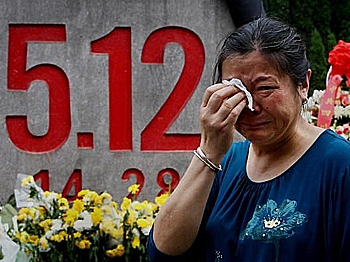 On May 11, 2009, earthquake survivors held a memorial service for lost family members. (Getty Images)