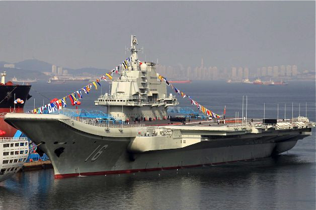 """China's first aircraft carrier, a former Soviet carrier called the """"Varyag,"""" docked in Dalian, in northeast China's Liaoning Province, on Sept. 24, 2012. The Chinese regime renamed the aircraft carrier """"Liaoning."""" (STR/AFP/Getty Images)"""
