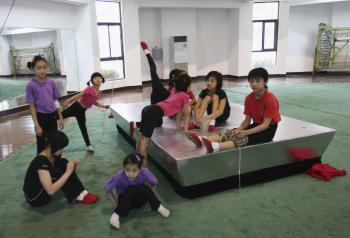 Young Chinese acrobats resting after training. In China enormous emphasis and funding are being given to elite sports, while neglecting sporting activities for the masses. The overall health of Chinese youth is in decline with the average fitness and health-related expenditure for a Beijing resident is only 73 yuan, ($11 US).  (Getty Images )