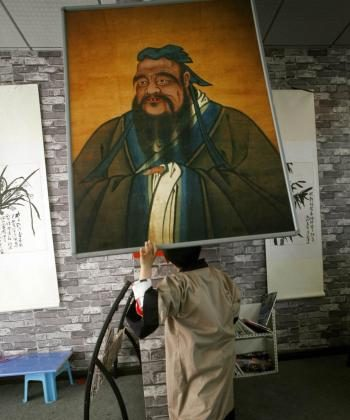 A Chinese boy looks at an image of Confucius, the ancient Chinese philosopher. (Liu Jin/AFP/Getty Images)