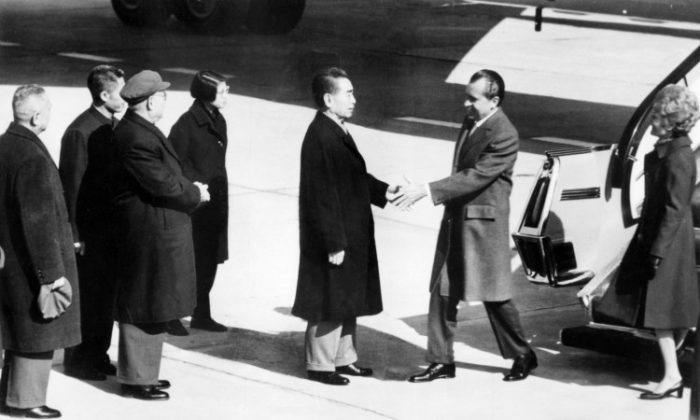 Chinese Premier Zhou Enlai welcomes U.S. President Richard Nixon during his official visit to Beijing, China on Feb. 21, 1972. Richard Nixon sought to play the China card as a way to gain advantage in the contest with the Soviet Union. (AFP/Getty Images)