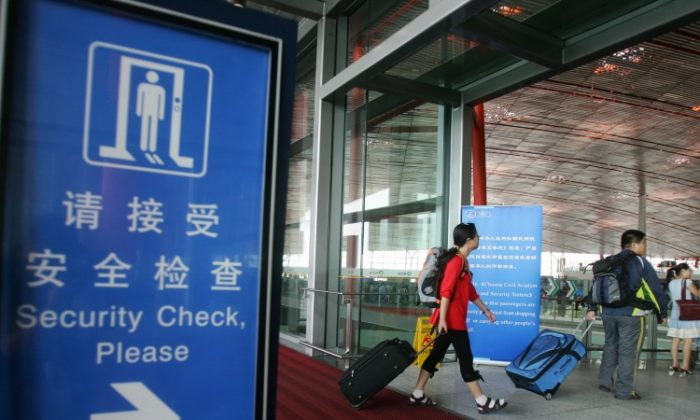 Beijing Capital International Airport on July 20, 2008 in Beijing. Overseas visitors transiting via Beijing will be able stay in the capital for up to 72 hours without a visa. (China Photos/Getty Images)