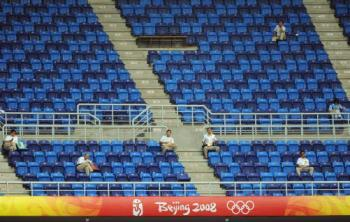 Rows of empty seats are seen during the women's first round group F football match at the Beijing 2008 Olympic Games in Tianjin on August 12, 2008. (Peter Parks/AFP/Getty Images)