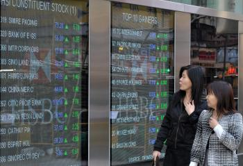 A board displaying stock prices on the Hang Seng Index in Hong Kong.  (Mike Clarke/AFP/Getty Images)
