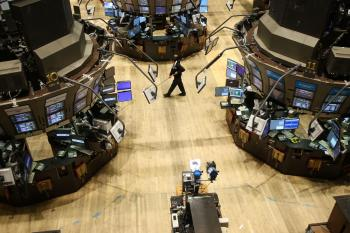 A janitor sweeps an empty trading floor at the New York Stock Exchange (NYSE)in New York City. (Spencer Platt/Getty Images)