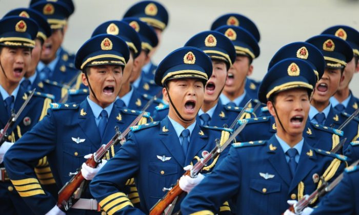 Chinese navy guards yell as they march in Beijing in 2009. The military question in the context of Bo Xilai's political drama remains inconclusive. (Frederic J. Brown/AFP/Getty Images)