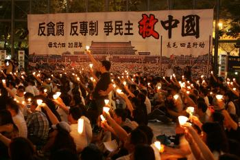 Thousands of protestors hold candles during a candlelight vigil for the 20th anniversary of June 4 Tiananmen Square Massacre in Beijing at Victoria Park on June 4, 2009 in Hong Kong. (MN Chan/Getty Image)