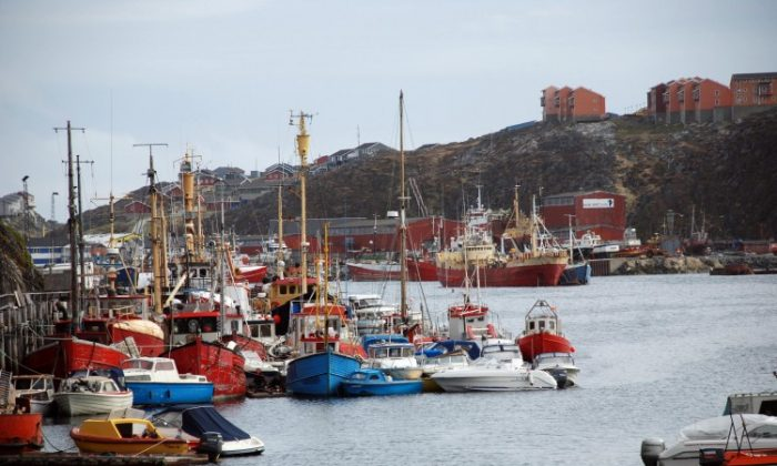 The port of Nuuk, capital of Greenland, July 6, 2009. Manufacturing could bring an influx of foreign workers to the Arctic island, heralding great change for the sparsely populated land. (Slim ALLAGUI/AFP/GettyImages)