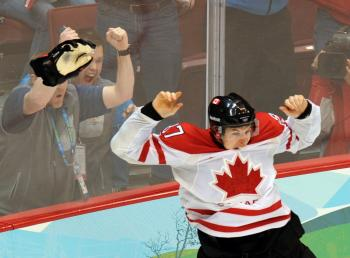 Sidney Crosby jumps for joy after scoring the overtime winner. Canada defeated the U.S. 3-2 to win the gold medal. (YURI KADOBNOV/AFP/Getty Images)