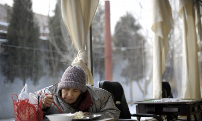 In a picture taken on Jan. 8, 2010 an elderly woman eats her lunch at a nursing house in Beijing. Expert estimates that more than 10 million only-children could die before the age of 25, leaving 20 million bereaved parents by their middle-age in China. (Liu Jin/AFP/Getty Images)