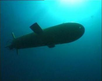 An Explorer-class autonomous underwater vehicle (AUV) operating underwater. The vessels are designed to operate autonomously underneath the Arctic ice shelf at depths of up to 5,000 metres. (Courtesy of ISE)
