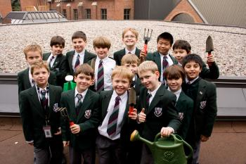 UP ON THE ROOF: Ashbury College students from the Junior School Environmental Club pose for a photo on the roof of the school's theatre where a green roof will be built.  (Samira Bouaou/The Epoch Times)