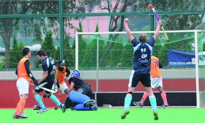 HKFC-A celebrate their first goal on the way to winning the top of the table clash against Khalsa-A last Sunday (Feb 5) at the HKFC Ground. (Bill Cox/The Epoch Times)