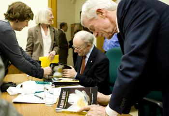 Co-authors David Matas (seated), an international human rights lawyer; and David Kilgour (R), a former cabinet minister and crown prosecutor; signing their new book at the Nov. 16, 2009, book launch of 'Bloody Harvest: The killing of Falun Gong for their organs.' (Samira Bouaou/The Epoch Times)