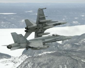 CF-18 Hornet fighter jets support the air defence of North America, train with Canada's allies, and respond to situations anywhere in the world throughout the year as part of Canada's commitment and contribution to international peace and security. Every Christmas they have the additional duty of escorting Santa Claus as he flies across Canada delivering presents to children. (Private Pierre Theriault, 3 Wing/CFB Bagotville Imaging Section)