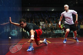 GOING TO THE WALL: Peter Barker (black shirt) of England plays a shot against James Willstrop (white shirt) of England during the ISS Canary Wharf Squash Classic. (Dean Mouhtaropoulos/Getty Images)