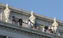 UC Berkeley Students Protest Education Cuts Atop Campus Building Ledge
