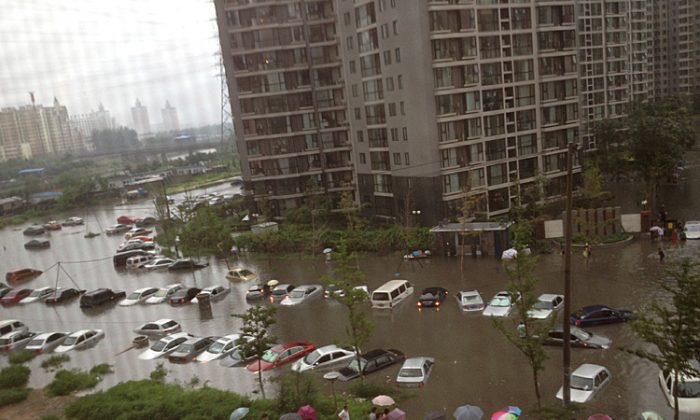 Flooding leaves many vehicles submerged in water in a residential community in Beijing on July 21. (The Epoch Times Photo Archive)