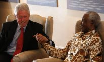 Bill Clinton Visits Mandela for 94th Birthday