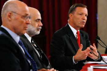 SEC Chairman Christopher Cox (R) testifies before the Senate Banking, Housing and Urban Affairs Committee on July 15 as Treasury Secretary Henry Paulson (L) and Federal Reserve Chairman Ben Bernanke (C) look on. (Chip Somodevilla/Getty Images)