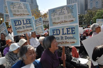 Elderly Lee supporters holding campaign posters for Lee on Oct. 15. (Epoch Times)