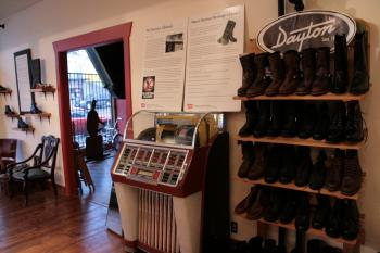 The Dayton Boots newly revamped showroom includes a 1950s juke box and hardwood floors made of Douglas fir recycled from the Stanley Park blow-down of December 2006. Dayton also sells apparel and accessories.  (Andrea Hayley/The Epoch Times)