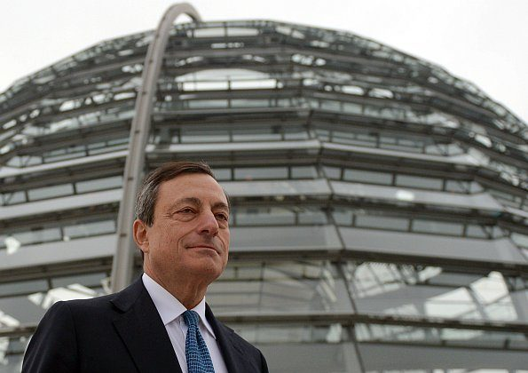 European Central Bank President Mario Draghi stands in front of the Bundestag, Germany's parliament, last week in Berlin. (Johannes Eisele/AFP/Getty Images)