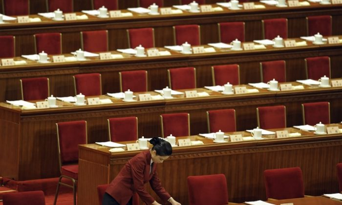 The Chinese Communist Party's 18th National Congress will take place on Nov. 8, 2012, in the Great Hall of the People in Beijing. At the Congress Xi Jinping will become Party General Secretary and Li Keqiang state premier. (Liu Jin/AFP/Getty Images)