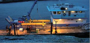 The two Arctic Explorers built for Natural Resources Canada (NRCan) being transported by boat. International Submarine Engineering Ltd. (ISE) delivered the two vessels to NRCan in September 2009. (Courtesy of ISE)