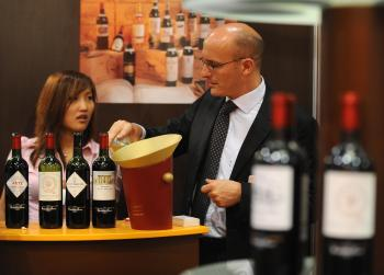 A booth of wines for sale is seen in Vinexpo, Asia's largest wine and spirits exhibition held in Hong Kong in May 2008. Exhibits and tradeshows are an excellent way to network, generate new businesses, and market your brand.  (ANTONY DICKSON/AFP/Getty Images)