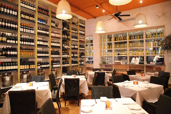 Wine and olive  oils from around  the Mediterranean  line the walls at  Fig & Olive. (Courtesy of Fig & Olive)