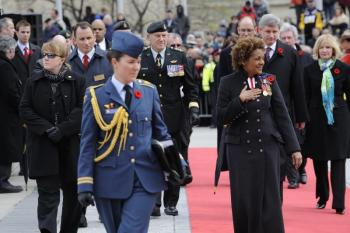 Governor General Michaelle Jean, Prime Minister Stephen Harper, and his wife Mrs. Laureen Harper attend the national commemorative ceremony on Vimy Ridge Day, April 9, 2010, at the National War Memorial in Ottawa to honour the First World War veterans of Canada. (Rideau Hall)