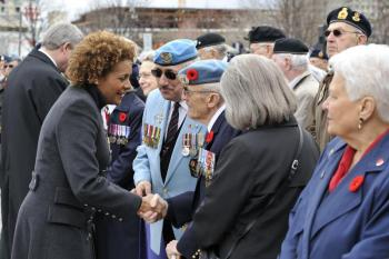 The governor general and prime minister speak with Canadian war veterans and their families at the Vimy Ridge commemorative ceremony in Ottawa on April 9, 2010. (Rideau Hall)