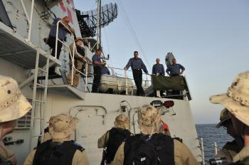 HMCS Fredericton Commander Steve Waddell gives final instructions to members of the Naval Boarding Party just before they were to head out to assist the Kota Wajar off the coast of Somalia. (Corporal Peter Reed, Image Technician, HMCS Fredericton)