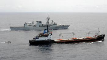 A rigid-hulled inflatable boat from HMCS Ville de Quebec ferries personnel to and from the freighter Abdul Rahman, Aug. 21, 2008. The warship is escorting the merchant vessel and her load of World Food Programme maize and soya meal from Mombasa, Kenya, to Mogadishu, Somalia, through the pirate-infested waters off East Africa. (Master Corporal Kevin Paul)