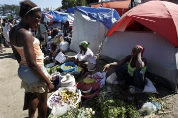 In this image provided by the United Nations Stabilization Mission in Haiti (MINUSTAH), Haitians buy and sell food among makeshift tents on Feb. 7 at the Petionville Club camp in Port-au-Prince where more than 50,000 displaced people have relocated for shelter following the 7.0-magnitude earthquake on Jan. 12. (Sophia Paris/MINUSTAH via Getty Images)