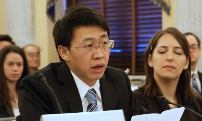 Hu Zhiming, a former officer in the Chinese Air Force, gives testimony to congressional Representatives on Dec. 18. Hu lost everything and spent over eight years in prison because of the Chinese Communist Party's persecution of Falun Gong and Hu's refusal to renounce his faith. (Lisa Fan/The Epoch Times)