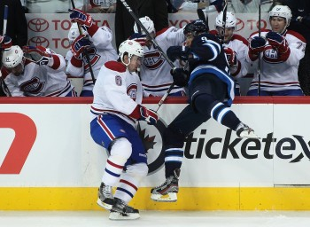 Evander Kane (R) and the Winnipeg Jets got the better of this collision but Montreal got the better of the scoreboard. (Marianne Helm/Getty Images)