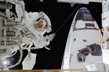 Astronaut John B. Herrington, STS-113 mission specialist, participates in the mission's third and final scheduled spacewalk to perform work on the International Space Station on Flight Day 8, Nov. 30, 2002. The forward section of the Space Shuttle Endeavour is seen on the right. (NASA)