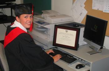 Blythe (Angel) Wesley, a 2008 graduate of Keewaytinook Internet High School, posing with her high school diploma. (Courtesy of Keewaytinook Internet High School)