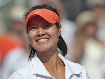 China's Li Na holds the trophy after winning over Italiy's Francesca Schiavone during their Women's final in the French Open tennis championship at the Roland Garros stadium, on June 4, 2011, in Paris. (AFP/Getty Images)