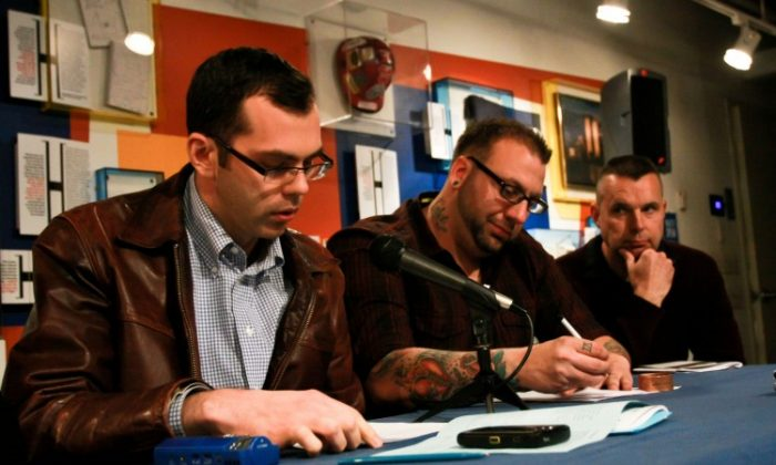 Veterans Jeremy Warneke (L), Matthew Mellina (C), and Daniel Grogul (R) share their writing at the Tribute WTC Visitor Center on Wednesday. (Tara MacIsaac/The Epoch Times)