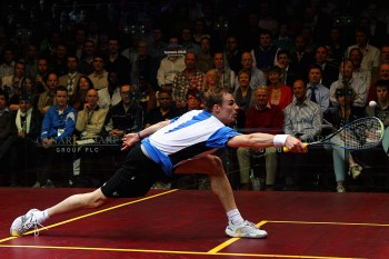 Nick Matthew of England stretches for the ball against Gregory Gaultier of France in their semi final match at the ISS Canary Wharf Squash Classic. (Dean Mouhtaropoulos/Getty Images)