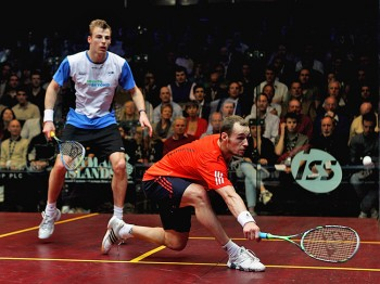 SQUASH ACTION: Nick Matthew (white shirt) of England and Gregory Gaultier (orange shirt) of France do battle on the squash court in their semi-final match at the ISS Canary Wharf Squash Classic, London, England on March 24, 2011. (Dean Mouhtaropoulos/Getty Images)