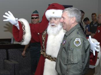 Santa Claus visits NORAD Headquarters in Colorado Springs, Colorado, Dec. 23, 2008, for a pre-flight briefing before his annual Christmas Eve flight. Over 1,200 volunteers helped with the NORAD Tracks Santa operation in 2008 to answer thousands of phone calls and e-mails from children around the world eagerly awaiting Santa's visit. (NORAD and USNORTHCOM Public Affairs)