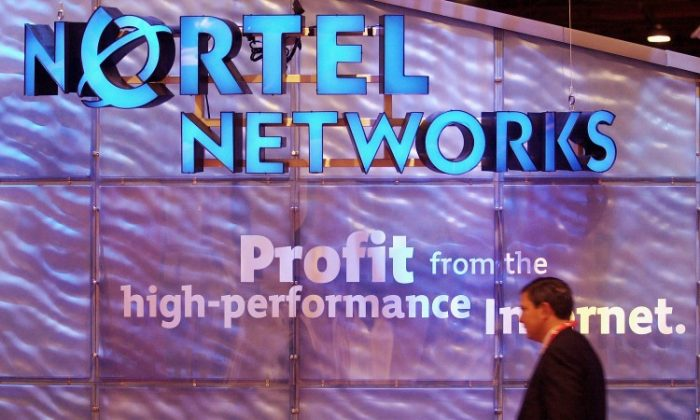 The Nortel Networks booth June 5, 2001, at the Georgia World Congress Center in Atlanta, Georgia, June 5, 2001. An Ontario Superior Court on Monday dismissed fraud charges against three former top executives at bankrupt Nortel Networks after a year-long trial involving one of the largest casualties of the 1990s dot-com bubble. (Erik S. Lesser/Getty Images)