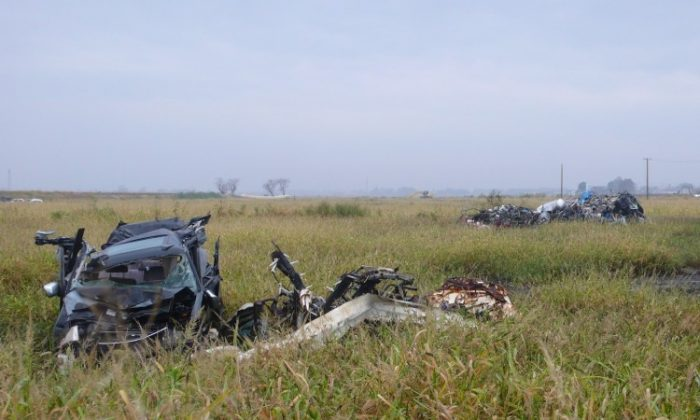 Mangled cars in the Arahama District of Sendai City still lie where they were deposited by the Japan tsunami on March 11. The now overgrown fields were thriving farms before the disaster. (Cindy Drukier/The Epoch Times)