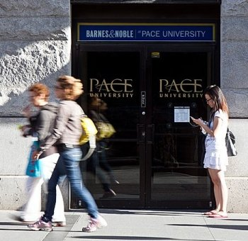 People walk past the Pace University in Manhattan. The associate-director at the Confucius Institute at Pace University said the Chinese regime has a 'right to ban' Falun Gong practitioners from volunteering at the Institute. (AMAL CHEN/THE EPOCH TIMES)