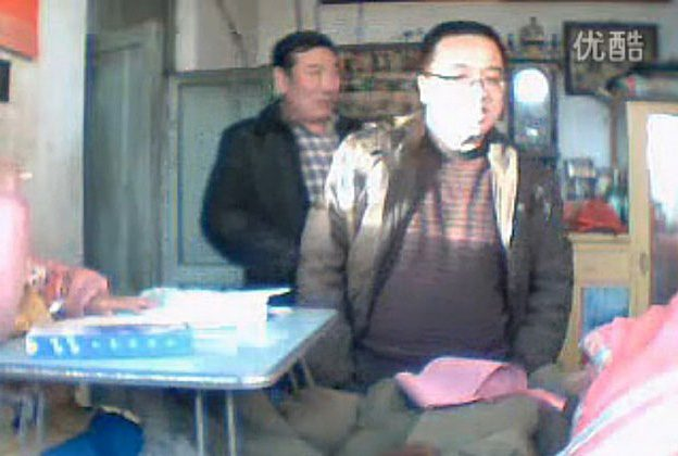 A video uploaded earlier this year, purportedly showing Qu Huagiang, shows a man speaking with a local Chinese Communist Party official regarding injury pay. Qu blew himself up on Monday at a government compound, apparently targeting local authorities, who Qu believed treated him unfairly. (Internet screenshot)